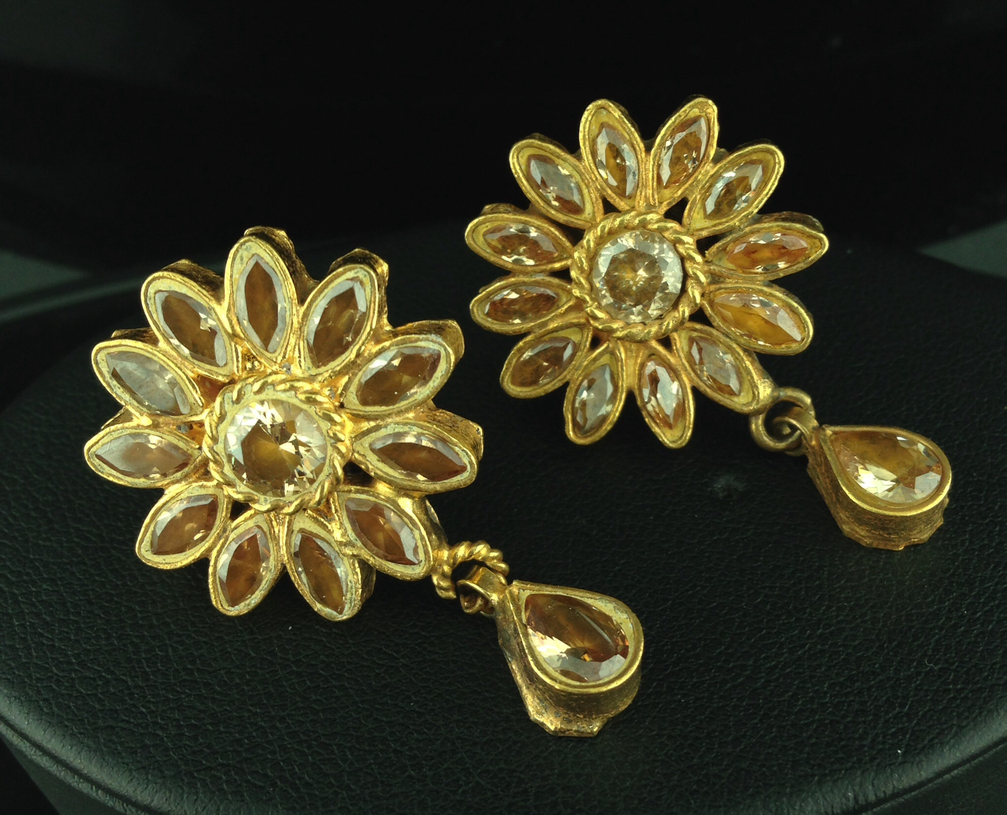 Flower Shaped Kundan Tops with Champagne Stones.