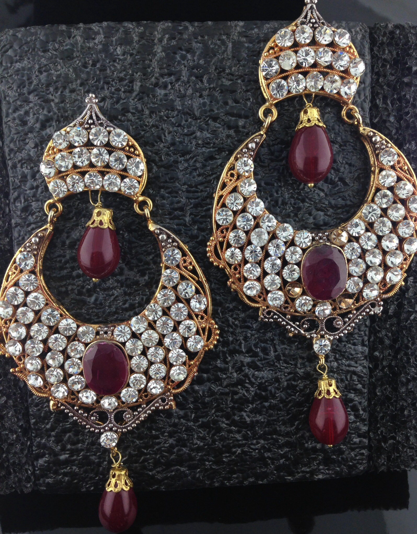Gold Polished Teardrop With Ruby And Crystals.