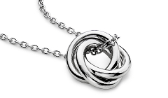 Simply perfect, this petite love knot pendant features