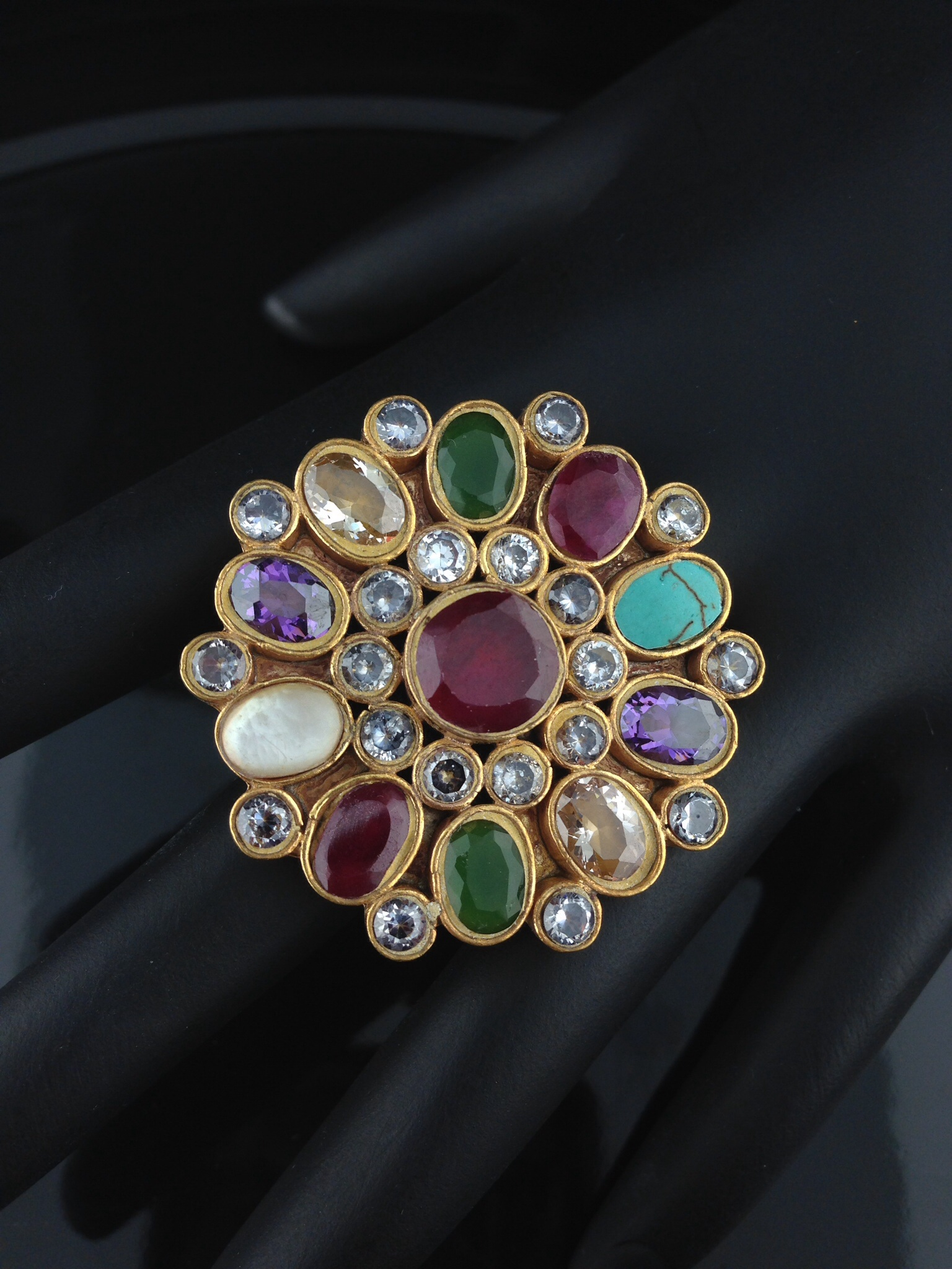 Adjustable Kundan Rings with multicolored Stones.